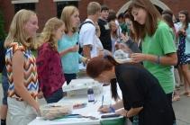 Kathleen Brandes, '15, represents Science Club as Karinn Kasbekar, '16, signs up. Photo by Emi Myers.