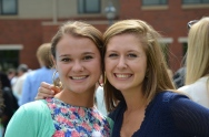 Theresa Frederick, '15, and Jessica Sullivan, '15 pose for a picture at the Kids-To-Kids table. Photo by Emi Myers.