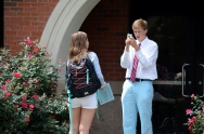 Eva Simmons, '15, gets interviews by Michael Hall, '15 about the Bazaar. Photo by Emi Myers.