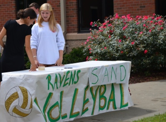 Shiva Boroojerdi, '15, talks to Jen Funsten, '15 at the Sand Volleyball Club table. Photo by Emi Myers.