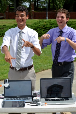 Justin Barber, '16, and Taylor Smith, '16, represent Robotics Club. Photo by Emi Myers.
