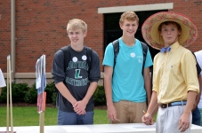 Corey McQueen, '15, and Sam Southerland, '15, sign up for Spanish club with co-President Jack Iseley, '15. Photo by Emi Myers.
