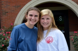 Rebecca Qubain, '15, poses with Jen Funsten, '15, at the Sand Volleyball Club. Photo by Emi Myers.